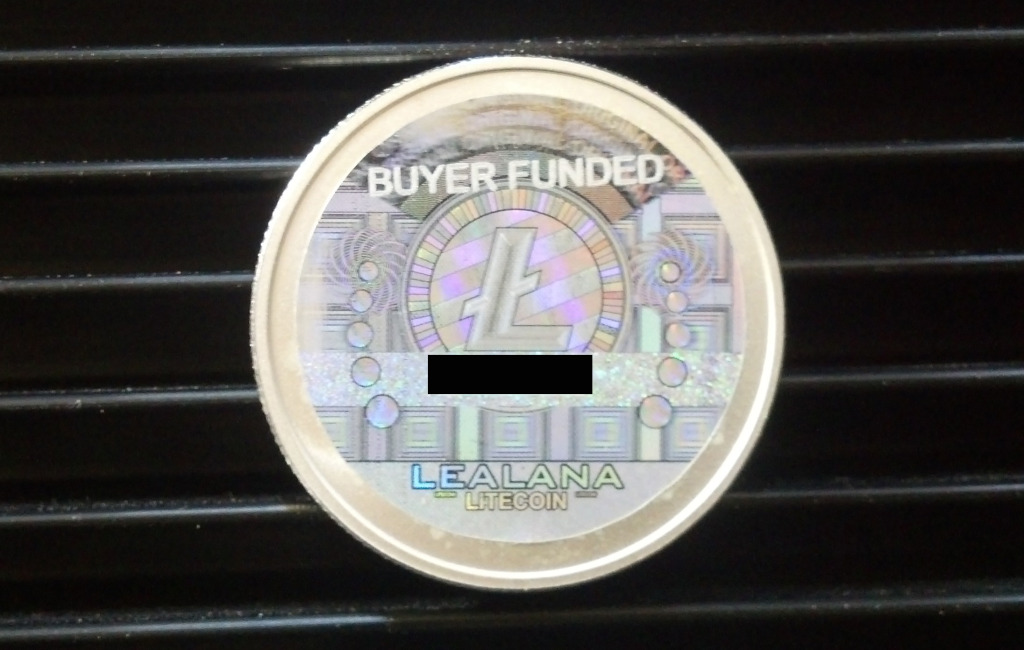 """A Lealana 10 LTC piece, now with """"BUYER FUNDED"""" designation on the hologram."""