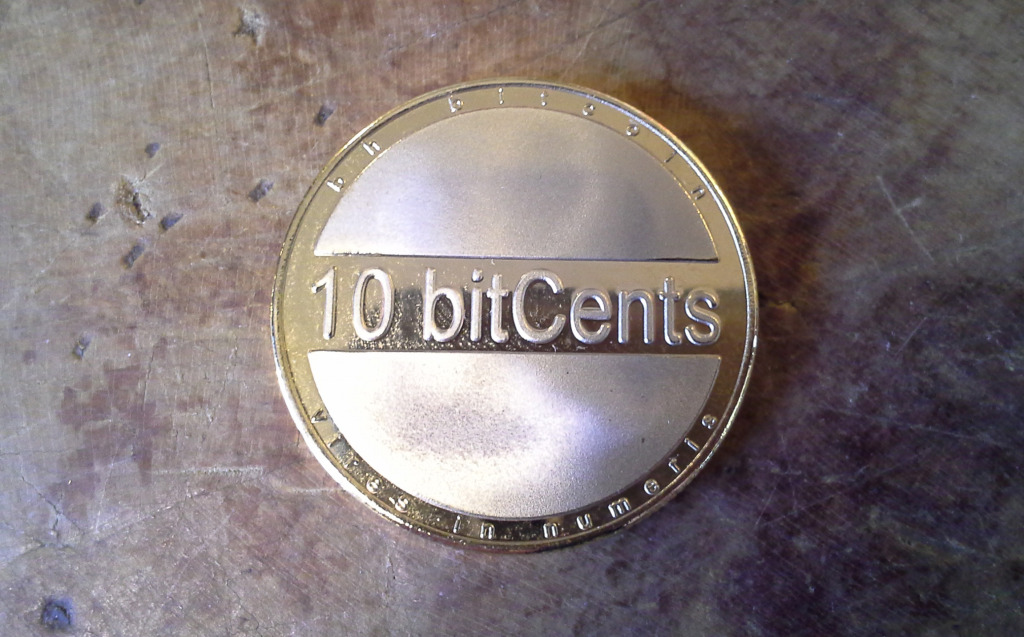 A series one bhCoin 10-bitcent brass piece.