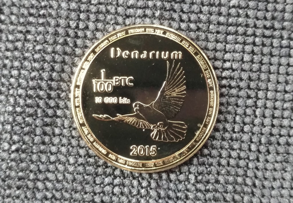 Denarium gold-plated 1/100 BTC piece.