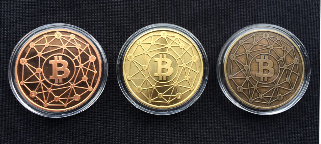 "Cryptopods ""Ravenbit Podified"" coins in copper, brass and bronze, obverse."