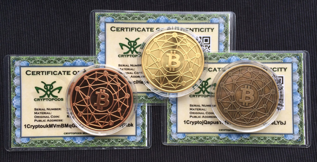 "Cryptopods ""Ravenbit Podified"" coins with laminated certificates of authenticity."
