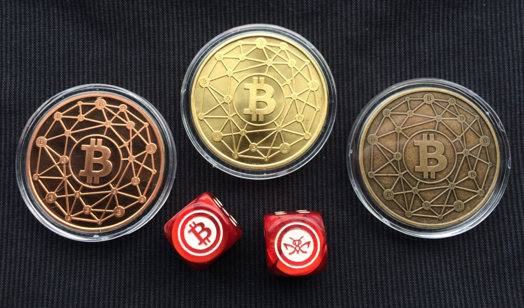 "Cryptopods ""Ravenbit Podified"" coins in copper, brass and bronze, with Bitcoin dice. The dice are darn cool."